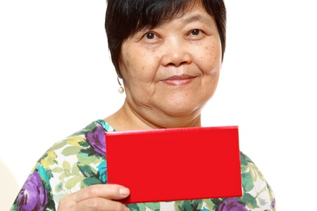 Asian woman holding a red card photo