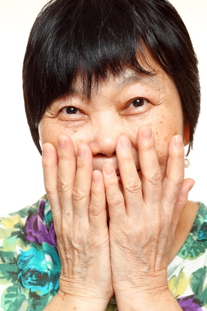 asian woman use hand cover her mouth photo
