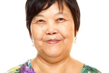 asian women: Happy 60s Senior Asian Woman on white background