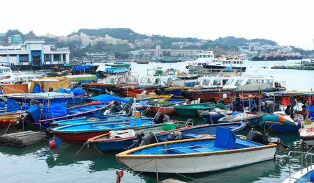 Fishing and house boats anchored in Cheung Chau harbour. Hong Kong.  Stock Photo - 11786405