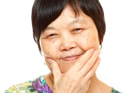 Senior Asian with hand photo