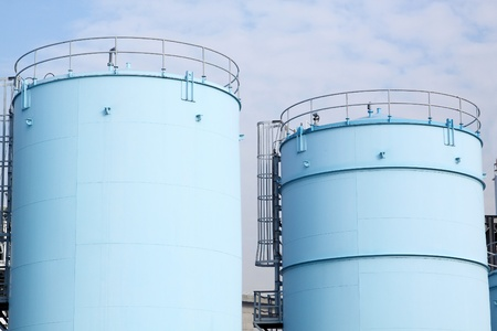 storage tank: large white tanks for petrol and oil in the Rotterdam harbor Editorial