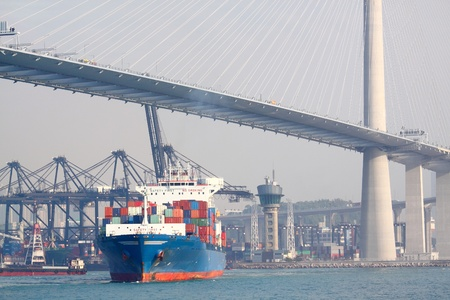 container ship and modern bridge Stock Photo - 12116792