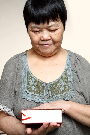 Senior womans hands holding an old book  photo