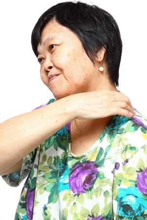 senior woman holding her aching back , massage herself Stock Photo - 12748417