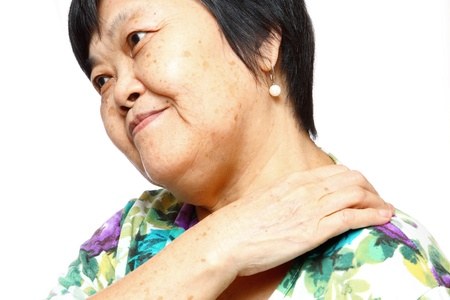 senior woman holding her aching back , massage herself photo