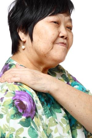 senior woman holding her aching back , massage herself Stock Photo - 12748630