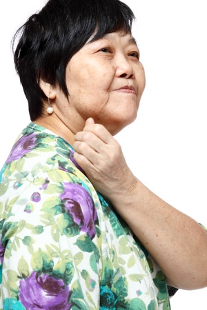 senior woman holding her aching back , massage herself Stock Photo - 12748519
