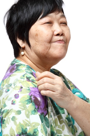 senior woman holding her aching back , massage herself Stock Photo - 12748658