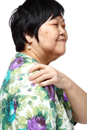 senior woman holding her aching back , massage herself Stock Photo - 12748656