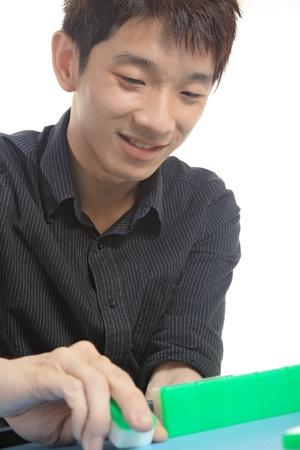 mahjong: Chinese man play Mahjong, traditional China gamble.  Stock Photo