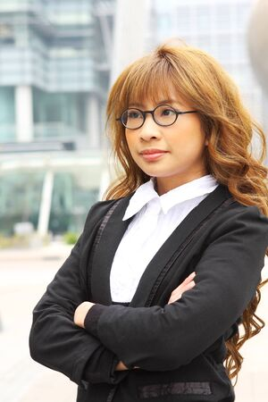 portrait of a young business woman in an office  Stock Photo - 12748550