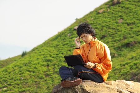 asain Man with notebook at day photo