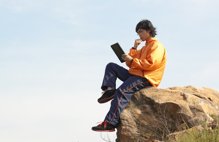 man with tablet outdoor at day photo