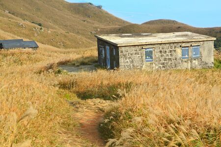 old stone house with grass on the mountain  photo
