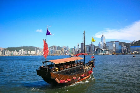 sail boat in asia city, hong kong photo