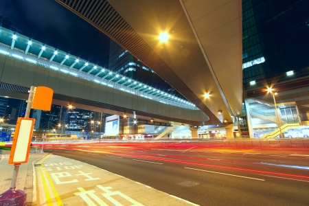 bustling: Modern urban landscape and the bustling streets in the evening