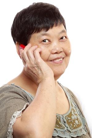 Senior Woman Talking On Mobile Phone photo