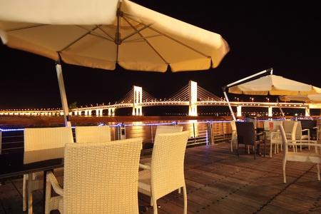 Street cafe at night in macau, sai van bridge as background Stock Photo - 14326626