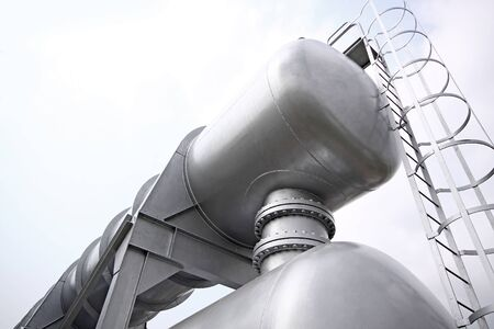 man nuts: Big gas container against sky