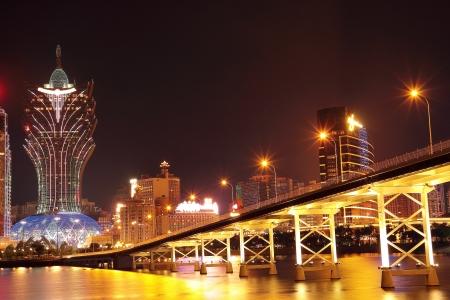 macau: Macao cityscape with famous landmark of casino skyscraper and bridge