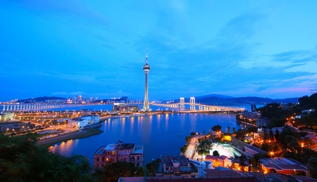 macau: Cityscape in night with famous travel tower near river in Macao, China.