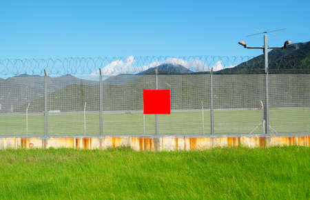 metal fence in the nature and red board for text Stock Photo - 16298862