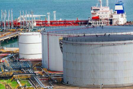 Oil tanks at day photo