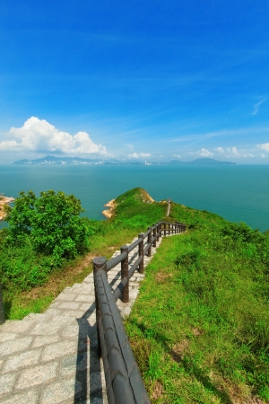 Hiking path surrounded by the sea  photo