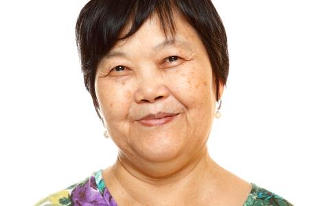 Happy 60s Senior Asian Woman on white background  photo