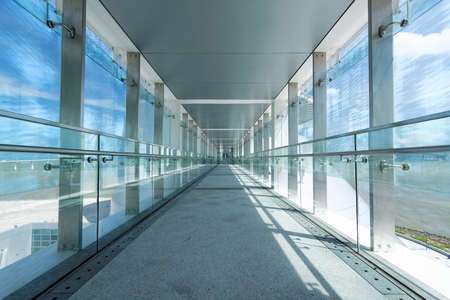 glass corridor in office centre  新聞圖片