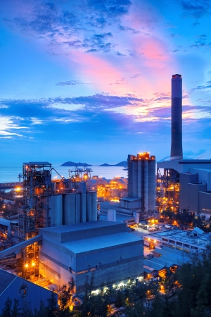power industry: coal power station and cement plant at night Editorial