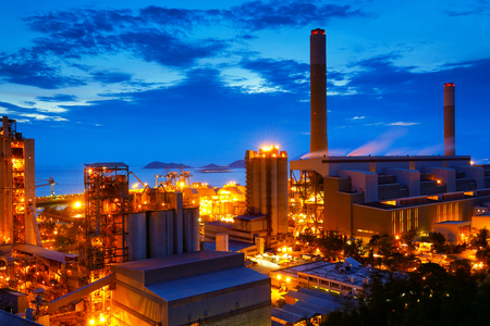 cement chimney: coal power station and cement plant at night Editorial