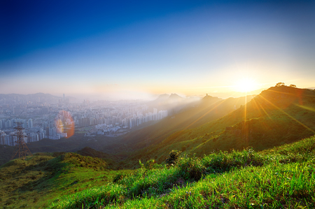 hong kong sunrise on mountain photo