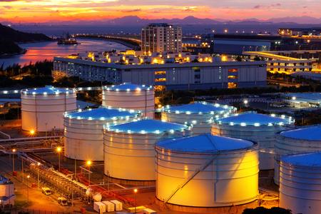 Oil tanks at sunset , hongkong tung chung Standard-Bild