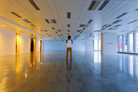 Man stand in empty floor Stock Photo - 23058816