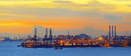 dockyard: Silhouette of several cranes in a harbor, shot during sunset.