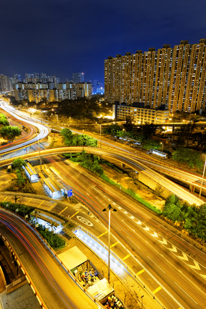 off ramp: Hongkong traffic night,aerial view of the city overpass Stock Photo