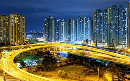 off ramp: traffic , aerial view of the city overpass at night, HongKong,Asia China
