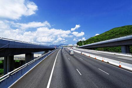 asphalt road in Hongkong, blue sky Stock Photo