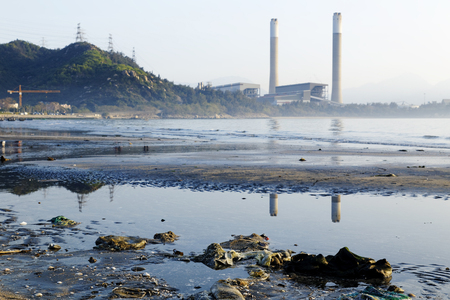 carbon pollution: electric power plant and pollution beach