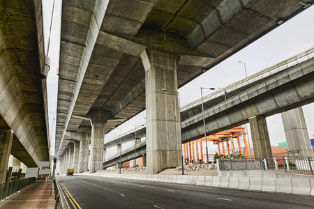 Empty asphalt road under the new expressway line at day Stock Photo - 28209972