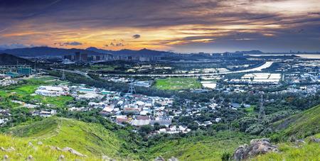 HongKong Asian city sunset , Yuen Long district, highway and paddy field rice , shooting at Kai Kung Leng