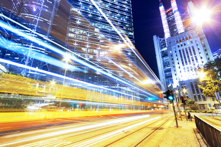 nightscene: hong kong modern city High speed traffic and blurred light trails  Stock Photo
