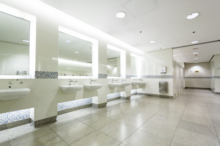 public toilet: interior of private restroom , toilet