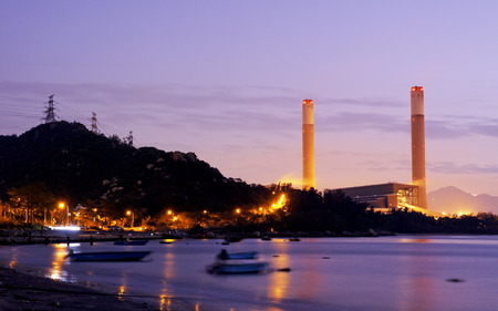 coal power station and cement plant at night  photo