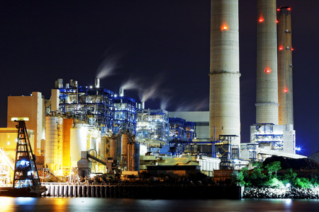 emission: power station at night with smoke Editorial