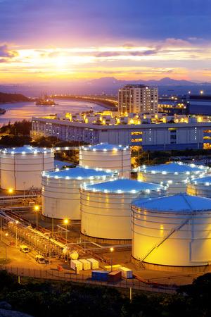 oil and gas industry: Oil tanks at sunset , hongkong tung chung Editorial