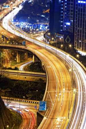 nightscene: hong kong modern city High speed traffic and blurred light trails