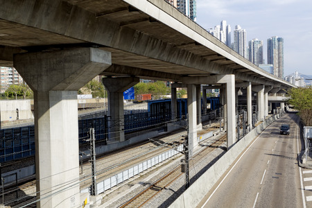 interchange: Freeway Overpasses and Train Tracks at day Stock Photo